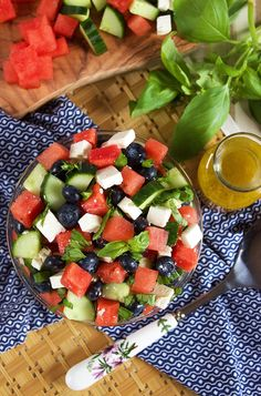 Refreshing and simple, this Watermelon Blueberry Feta Salad with Cucumbers recipe is the perfect summertime side dish! Ready in minutes!! | TheSuburbanSoapbox.com