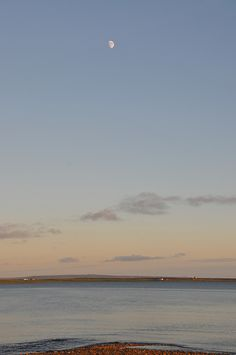 A beautiful calm June evening on Islay, the Moon has risen high over Loch Indaal at Uiskentuie