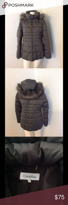 "Calvin Klein Gray Puffer Down Hooded Parka Coat L Very nice CK gray parka. Zip up high neck with a removable faux fur trimmed hood. Puffer down - duck down and water fowl feathers. Size Large - runs true to size. Great condition. Chest 44"" Length 27"" Calvin Klein Jackets & Coats Puffers"