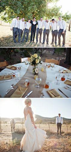 Table with burlap and suspenders groomsmen