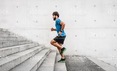 sporty man running up steps in urban setting royalty-free stock photo