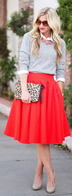 a grey sweater over a white blouse & red full skirt styled with nude pumps