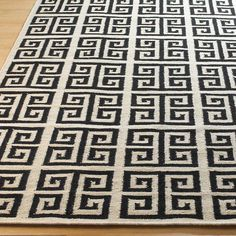 Greek Key Dhurrie Rug: 4 Colors Showcasing a labyrinth of Greek Key design, this reversible wool dhurrie speaks to the past and the present! In Black, Sea Blue, Gray Sky, or Khaki on Cream, adding a graphic design element to any room. 100% wool.