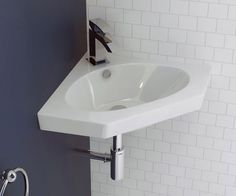 Cubitt Designer Corner Wall Hung Basin. Intelligent design makes this compact corner basin is perfect for cloakrooms and small bathrooms.