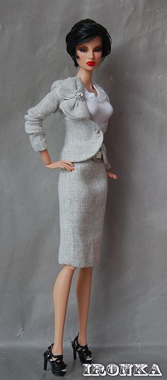 Fashion royalty doll with short hair... she looks different!  I like her gray suit