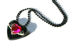 Hey, I found this really awesome Etsy listing at https://www.etsy.com/listing/153679164/winged-heart-necklace-black-pink-resin