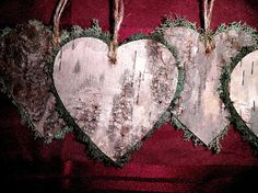 These Rustic Ornaments are made with very rustic picks of Birch bark, cut into hearts, and bordered with Green Deer Moss. Each it topped off with a twine hanging device.    A Perfect touch for that Rustic Christmas Tree, Gift Tags, adding to wreaths, or adding to garland. Many possibilities.    These Rustic Hearts Measure: 3 inches by 3 inches    Listing is for a set of 12 Ornaments