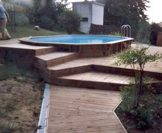 An octagonal swimming pool and a terrace are . Above Ground Pool Landscaping, Above Ground Pool Decks, Small Backyard Pools, Backyard Pool Designs, Diy Pool, Above Ground Swimming Pools, Small Pools, In Ground Pools, Swimming Pool Heaters