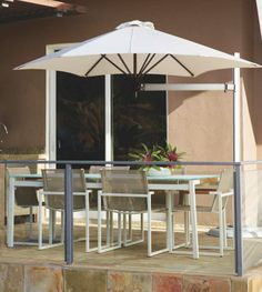 Even the most avid sun worshippers sometimes long for a place in the shade. The Paraflex Single Pole Mount Umbrella lets you create your own shade wherever you want – in the right spot – at the right time. | Frontgate: Live Beautifully Outdoors