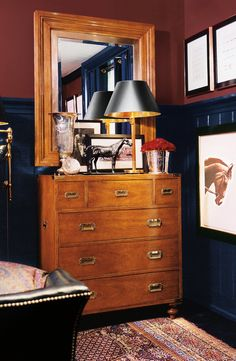 Saturated classic colors make for a seriously cozy bedroom. Walls painted in Ralph Lauren Paint's Red Damask trimmed with Club Navy.
