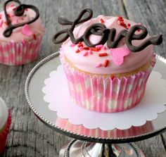Valentine's Day calls for something special, especially when it comes to sweets. Decorating your favorite-flavored cupcakes with impressive chocolate cupcake toppers will earn you tons of oohs and aahs. - Everyday Dishes & DIY