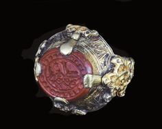 A SELJUK GOLD RING WITH INSCRIBED SEAL, IRAN, 12TH-13TH CENTURY