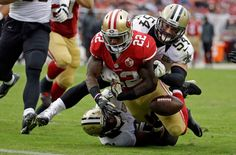 Saints vs. 49ers:  November 6, 2016  -  41-23, Saints  -     San Francisco 49ers running back Mike Davis (22) fumbles the ball near the goal line as New Orleans Saints inside linebacker Nate Stupar (54) and free safety Jairus Byrd, bottom, look on during the second half of an NFL football game Sunday, Nov. 6, 2016, in Santa Clara, Calif.