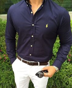 Like this style, navy blue shirt with white trousers.