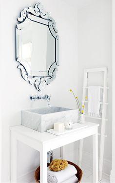 marble vessel sink, venetian mirror