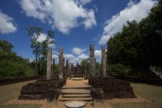 the beautiful image house with the three standing and 2 seated Buddha statues is closer to the entrance to the Medirigiriya sacred site