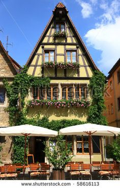 stock photo : Quaint cafe in Rothenburg, Germany with flowering window boxes