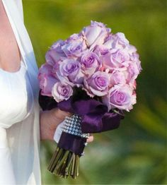 Love the light purple flowers and dark purple ribbon - for the bridemaids