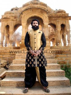 Black golden motif embroidered raw silk kurta and golden zari work. Item Code : SKB3412W http://www.lalitkhatri.com/label/men/dhoti-kurta.html