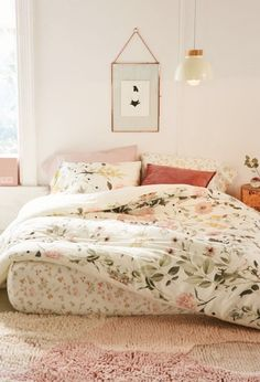 Feminine boho bedroom with floral duvet