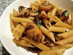Mushrooms in Pasta with a white wine sauce