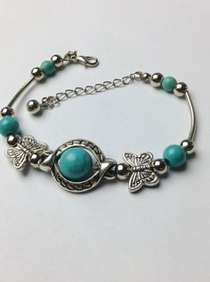 A personal favorite from my Etsy shop https://www.etsy.com/listing/82004315/butterfly-turquoise-tibetan-antique