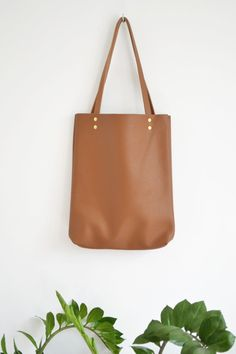 c0b8d6615bcc Casual and simple tote bag made from high quality pebbled leather. It is  slim