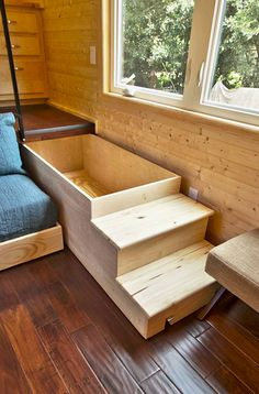 The stairs to the 'raised' kitchen pull out to offer storage space. Tiny Home Builders