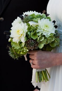 Designed by Moss Fine Floral, bridal bouquet of green hydrangea, white dahlias and succulents