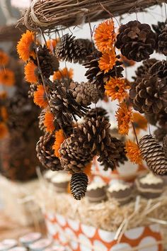 I really like this. Maybe have them hanging, but pine cones with dried orange flowers.