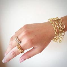 Loving gold links for the wrist. Bracelets and rings from J.J. Marco on Madison Avenue in New York City.