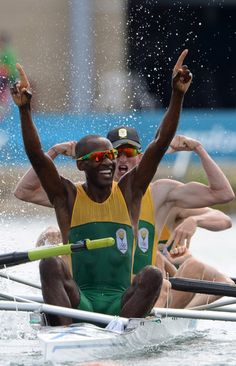 Sizwe Ndlovu, John Smith, Matthew Brittain and James Thompson of South Africa celebrate after winning gold in the Lightweight Men's Four final on Day 6 of the London 2012 Olympic Games at Eton Dorney on August 2, 2012 in Windsor, England.