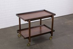 Danish Modern Rosewood Bar Cart by Poul Hundevad   From a unique collection of antique and modern bar carts at https://www.1stdibs.com/furniture/tables/bar-carts/