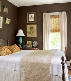 Use this bedroom as a design inspiration on neutral linens and vintage prints.