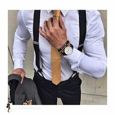 White shirt, suspenders with a gold tie.