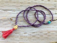 $78 - ABUNDANCE MINI MALA    Live from a mindset that everything is abundant and limitless. Gorgeous layers of vibrant purple magnesite wrap the wrist and are complemented by a solid turquoise nugget, a carved bone and white magnesite. This mini mala is designed to remind the wearer that there is always more. The world is your oyster!  Mala is strung on stretch cord, making it a versatile piece, which can be worn as a necklace or bracelet.