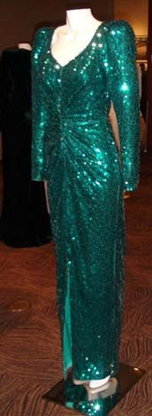 Lot 50. Christie's Auction. Designed by Catherine Walker .V necked gown adorned with green/blue sequins embroidered by Jacob Schlaepfer . Diana wore this gown in 1986 to a film premiere and in 1990 to the Diamond Ball. $24,150.00 Purchased by a woman from Florida. Sold March 2013 by Kerry Taylor auctions £90,000