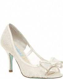 "$99.50. Finish off your bridal look with these ultra-feminine lace peep toe pumps!  Blue by Betsey Johnson lace peep toe pump with bow.  Available in Ivory.  Heel height: 3"".  Imported."