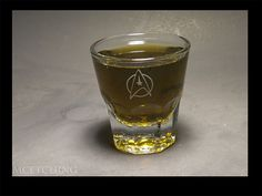 """Starfleet 4 oz shot glass.  Perfect for Aldebaran Whiskey. Take a drink anytime you hear the words """"inverted"""", """"Graviton"""", """"Tachyon"""", or """"Emitter""""."""