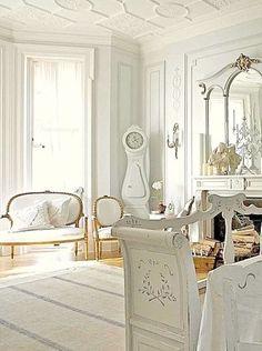 Gorgeous white living room. Love the white painted hardwood floors.  #whitelivingroom