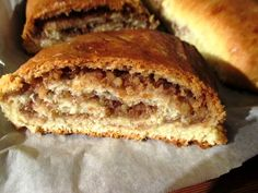Hungarian Nut Roll.   Filling has 1/2  lb. walnuts (maybe almonds instead?)  1 cup apricot preserves  1/4 cup sugar  Grated zest of 1 lemon  1/2 cup light raisins (optional)