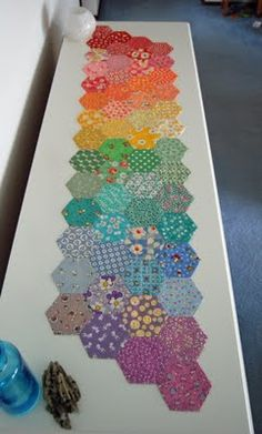 hexagon table runner -- interesting use of hexies.  Might have to try this.