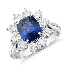 This ring makes a statement with an extraordinary 3.17 carat cushion-shaped sapphire surrounded by over a carat of brilliant round diamonds set in platinum.
