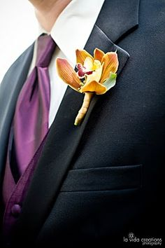 This might be my favorite boutonniere and i think that tie color is the same for our groomsmen too.