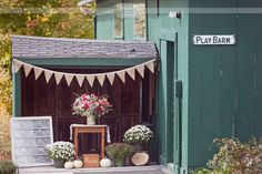 Entrance to the camp style Woodbound Inn wedding barn in Rindge, NH... this venue is perfect for a quintessential rustic New England wedding - it has a lakeside outdoor ceremony site, which is a short walk to the reception barn... plus it has an inn on site where guests can sleep!
