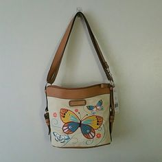 Rosetti Purse 100% cotton w/ vinyl trim. Colorful butterflies on front of purse. Rosetti Bags