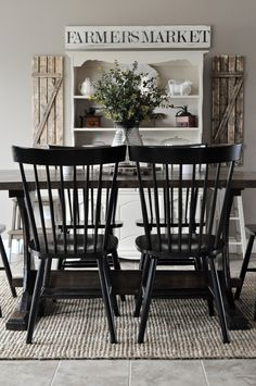 Farmhouse Style Dining Room With Jute Rug