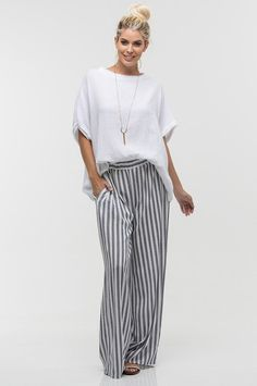 Casual vintage black and white striped wide leg pants Shown here paired with the Georgina Top 100% rayon Hand wash cold, dry flat Not sure how this style will l