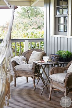 CABIN FERVOUR: On the merbau deck, wicker armchairs and vintage-style cushions create a cosy corner.