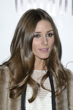 Olivia Palermo: Always the Fashion Week darling, Olivia Palermo wore her silky strands in loose waves with a pop of pink on her lips front row at Topshop Unique.